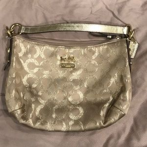 Gold coach bag